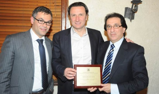 Mr. Athos Christou and Mr. Theoharis Alaveras (Beirut Hellenic Bank) with the president of the GOCMV.